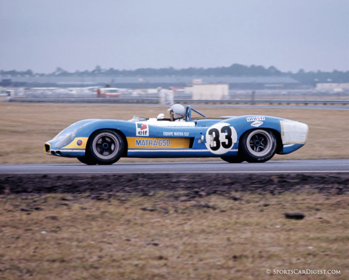 Three-time World Driving Champion Jack Brabham driving his factory Matra MS650 during practice for the Daytona 24. The patch on the left rear corner panel hides damage incurred during the transport from New York to Daytona. (Fred Lewis photo)