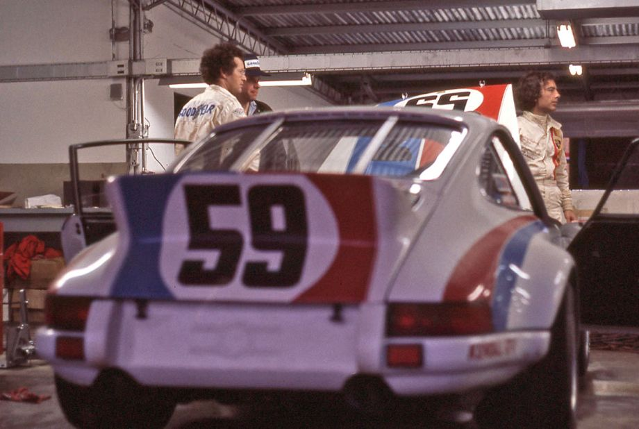 """Peter Gregg in the Brumos garage standing next to the """"factory owned"""" 911 Porsche Carrera RS.  On the far right is Andrew Carduner who would drive the #58 Brumos Porsche 911S that was a DNF.  Richard A. Reeves photo."""