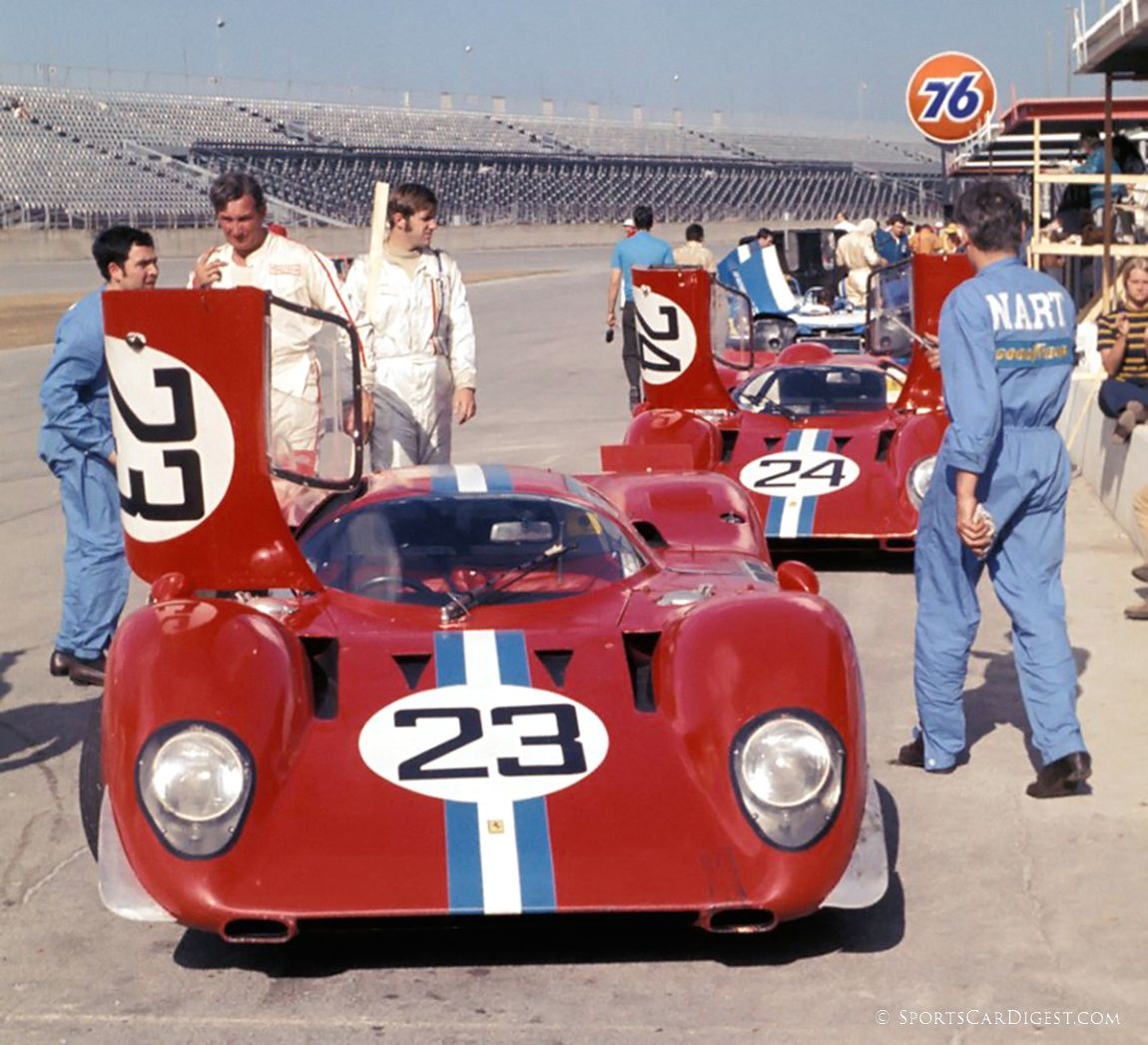 Mike Parkes and Sam Posey in the pits with two NART Ferrari 312P coupes. Sam and Mike would finish 4th overall in the #24 car. (Harry Hurst photo)