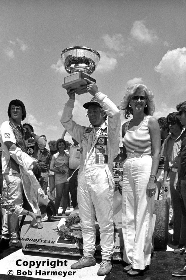 Gordon Johncock lifts the trophy after winning a USAC Champ Car race en route to the 1976 national championship.