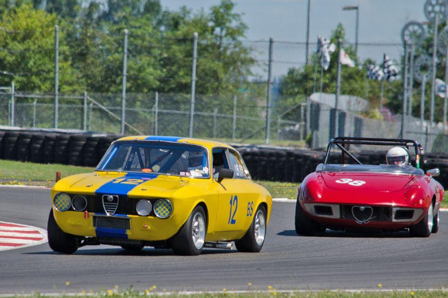 Don Forrester, 1969 Alfa Romeo GTV, and Save Nichols, 1971 Alfa Romeo Spyder. Photo by Paul Smith, 2013)