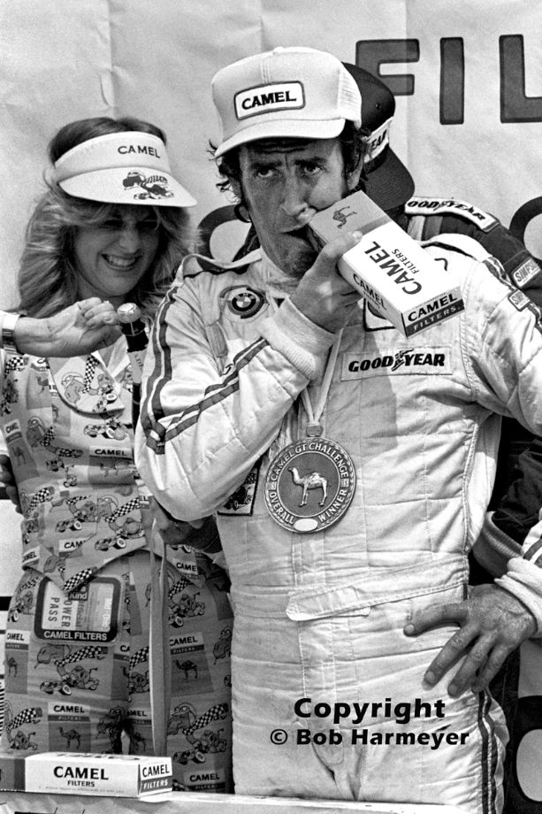 David Hobbs maximizes product identification for IMSA's series sponsor after winning a Camel GT race at the Mid-Ohio Sports Car Course in 1977.