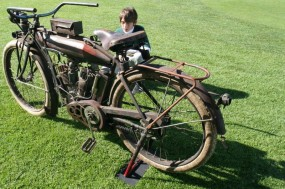 We can only imagine what the boy thinks of this century-old Indian Big Twin that made all of seven horsepower. The 1911 motorcycle was built in Springfield MA the same year Indian bikes scored a 1-2-3 sweep at the Isle of Man TT races. This machine is owned by Fred Johansen.