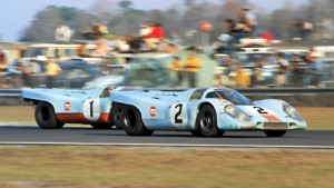 Coming out of the old turn 3 on the Daytona course is the first place 917 of Rodriguez and Oliver and the Porsche 917 of Jo Siffert and Derek Bell.