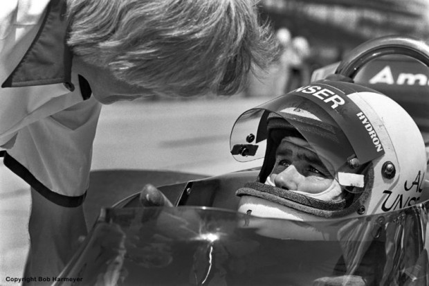 Al Unser speaks with a crew member during practice in 1977. Unser qualified and finished third in the Vel Miletich Parnelli VPJ6B.