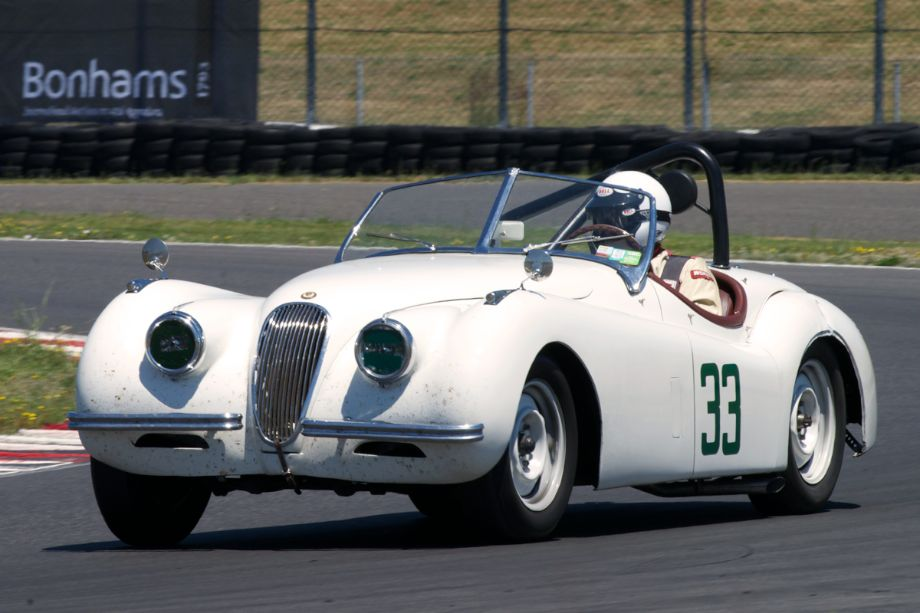 Jim Alder's XK120 Jaguar in turn twelve. Jim drove the Jaguar to Portland from Reno with all his spares and luggage in the Jaguar. He suffered a broken axle early in the weekend, pulled a spare axle out of the trunk spent all night repairing the Jaguar and raced the following day.