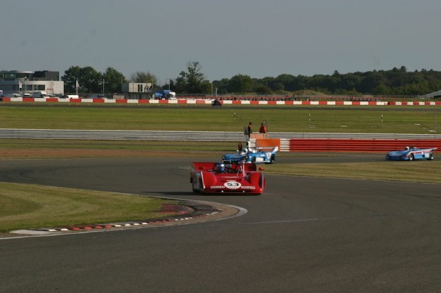 The first lap of the race and Paul Knapfield has slotted the Ferrari 712 in front of pole-sitter Rob Hall in the Matra, as David Gathercole slipped into 3rd in the Lola T290. Photo: Ed McDonough