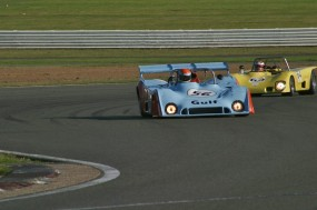 Devis in the Mirage gets by the Lola T280 DFV at the Abbey Chicane. Photo: Ed McDonough