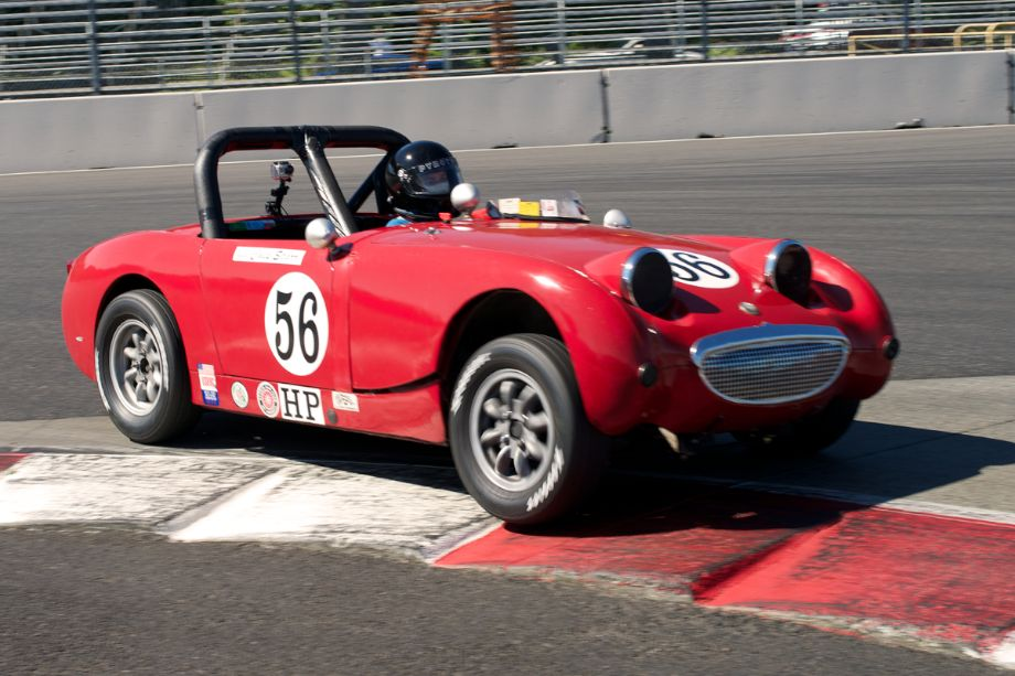 1960 Austin-Healey Sprite driven by Chip Starr in turn one.