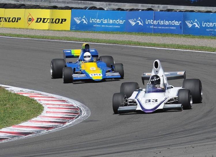 Enjoying two strong finishes was Shayne Windelburn seen here leading the similar Lola T400 of Glenn Richards