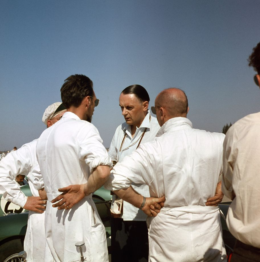 John Wyer, Aston Martin team manager, discusses strategy with the team mechanics prior to the start of the 1956 Sebring 12 Hours