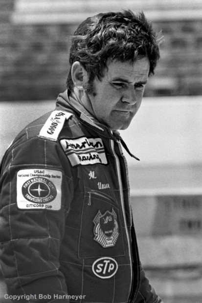 Al Unser walks through the pit lane before practice in 1977.