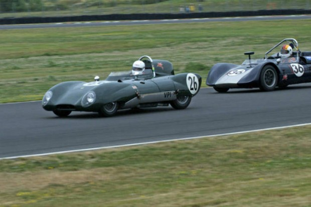 Lotus Eleven of Jacqulyn Mincheff leads the Crusader Sports Racer of Ron Federspiel into Turn 6