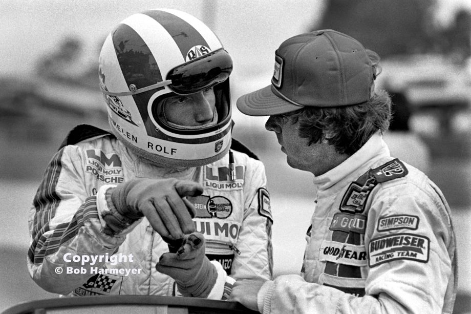 Rolf Stommelen (left) speaks with co-driver Rick Mears during practice for the 12 Hours of Sebring in 1979. Starting from pole position in a Porsche 935 entered by Dick Barbour, the team finished fourth.