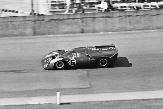 <strong>Close-up of the eventual winning Penske Lola T70 Mk IIIB. After the collapse of the factory Porsches and the John Wyer GT40s, they would make up a 200-mile deficit to inherit the lead and eventually win. Note the copious amounts of duct tape on the left front fender. This was due to contact with one of the 908's during the race.</strong>