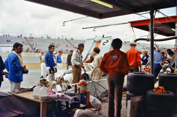 Driver change for the leading (just barely) Porsche in the 1971 24 Hours of Daytona.  Pedro Rodriguez has just entered the car and Jackie Oliver is standing next to the pit wall getting a drink.  Rodriguez's hard driving technique probably did more to win this event than the car itself.  Both the Adamowicz/Bucknum 512s Ferrari and the Donohue/Hobbs 512M gave Porsche a run for its money.