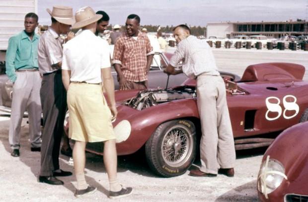 Nassau, Bahamas, December 1956.  John Edgar (brimmed hat, slacks) watches with group as Joe Landaker tightens plugs on the Edgar Ferrari 857S.