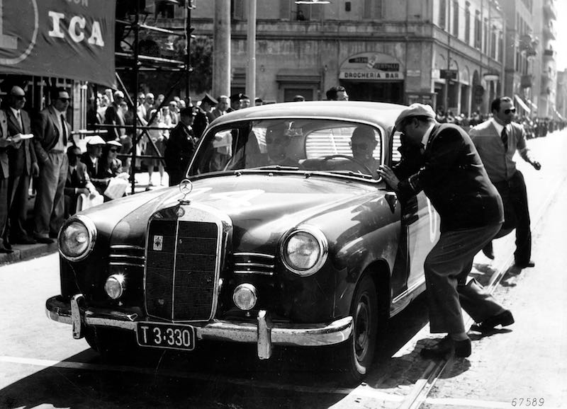Mille Miglia, Brescia in Italy, 1 May 1955. Winner in the diesel class: senior engineer Helmut Retter (Daimler-Benz representative in Innsbruck) with co-driver Wolfgang Larcher in a Mercedes-Benz Type 180 D (W 120), start number 04, at a checkpoint.