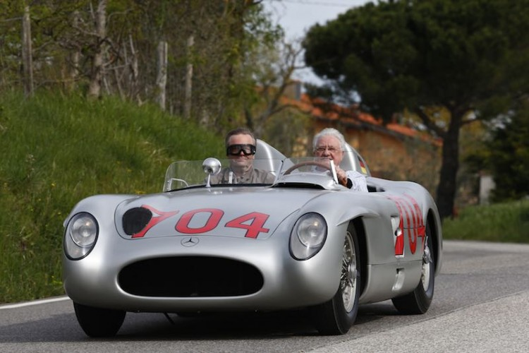 Hans Herrmann at the wheel of the 300 SLR with starting number 704
