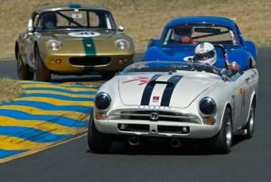 1964 Sunbeam Tiger John Morton leads 1964 Ginetta G4R of Robert Forbes and 1964 Lotus 26R of John Delane
