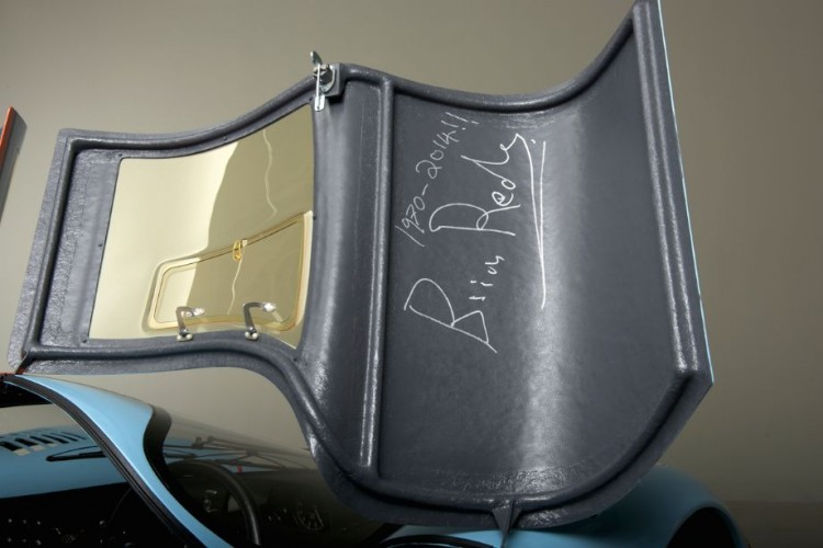 Lightweight construction utilizing aluminum tubing and thin fiberglass. Brian Redman's signature adorns the driver's door.