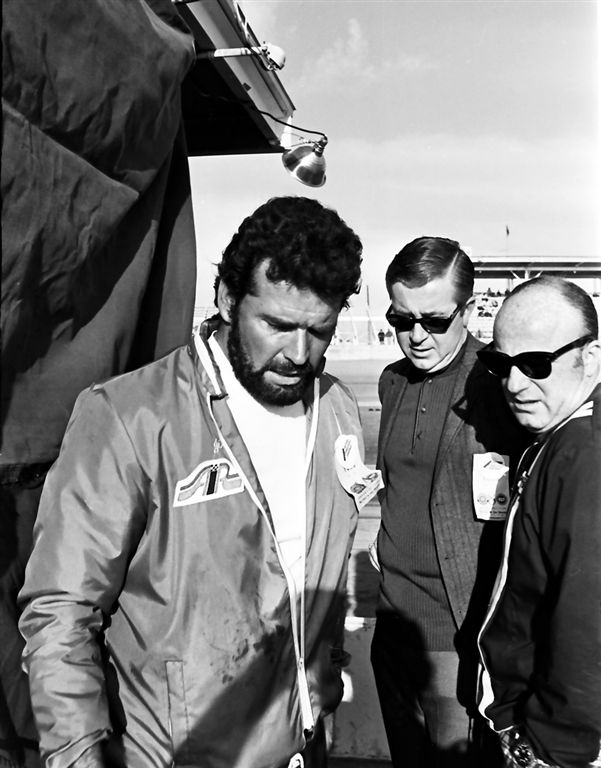 Photo of James Garner wearing his AIR jacket taken in the pit area at the 1969 24 Hours of Daytona. Standing next to him is Bill France, Jr.  Not sure who the other fellow is.