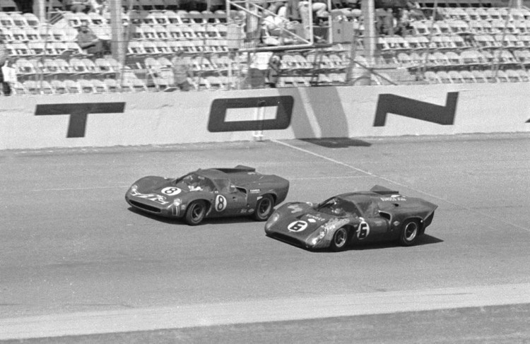 The first place finisher #6 Sunoco Penske Lola T70 Mk 3B of Mark Donohue and Chuck Parsons crossing the start/finish line alongside the second place car #8 AIR Lola T70 Mk 3B of Ed Leslie and Lothar Motschenbacher