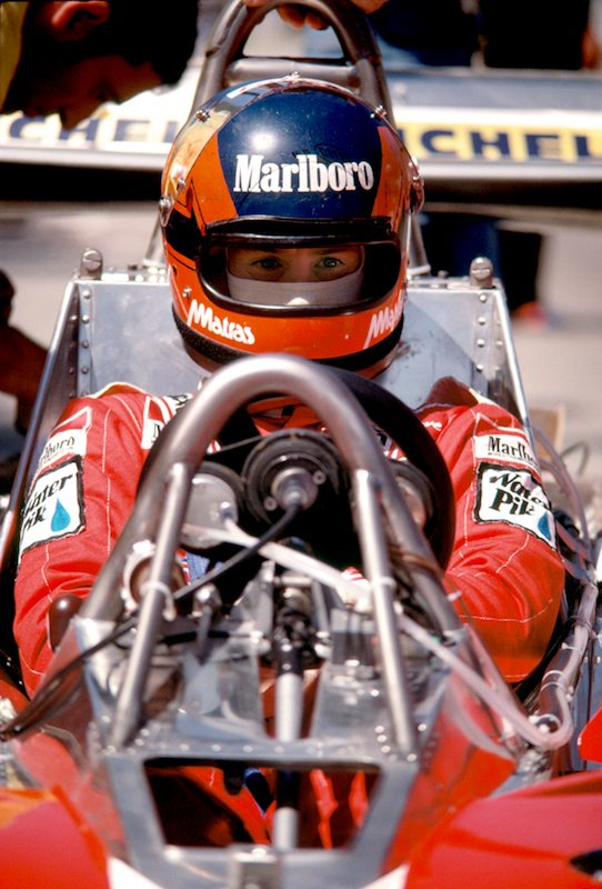 Ferrari driver Gilles Villeneuve waits out last minute adjustments to his Ferrari 312 T3 during the 1978 United States Grand Prix West at Long Beach. He qualified second to Reutemann and crashed - while leading - on lap 38 of 80.