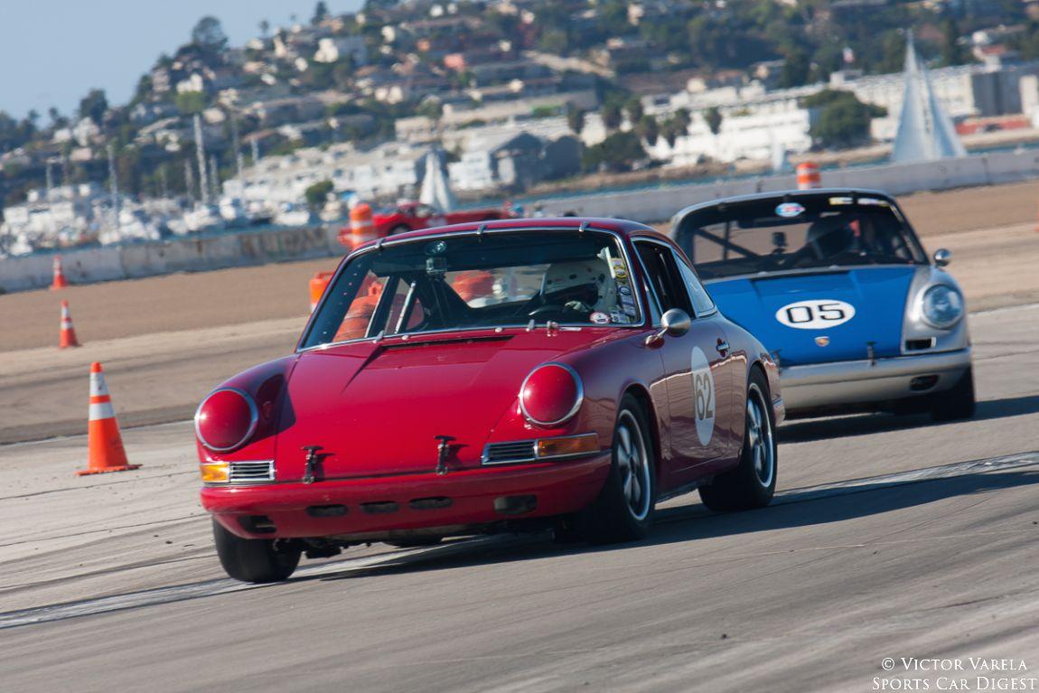 Erich Wilms keeps the #5 Porsche behind his 1967 Porsche 911S.
