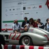 Sir Stirling Moss in the Mercedes-Benz 300 SLR he drove to overall victory at the 1955 Mille Miglia