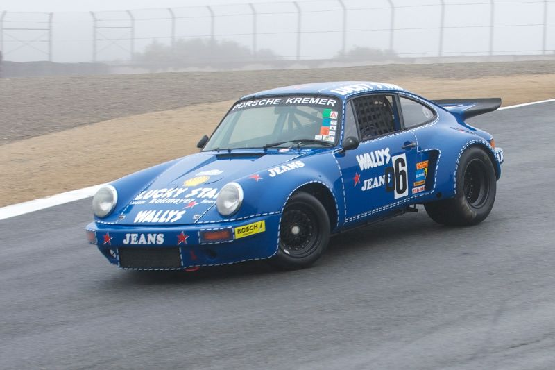 Robert Newman's Porsche RSR on a wet track.