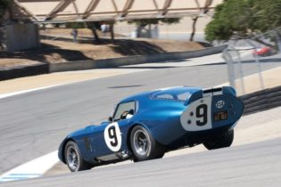 Down the Corkscrew goes Rob Walton in his 1965 Shelby Cobra Daytona Coupe.