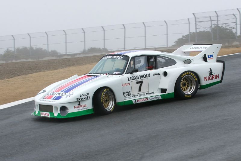 1979 Porsche 935J driven by Stephen Harris on a wet slippery tra