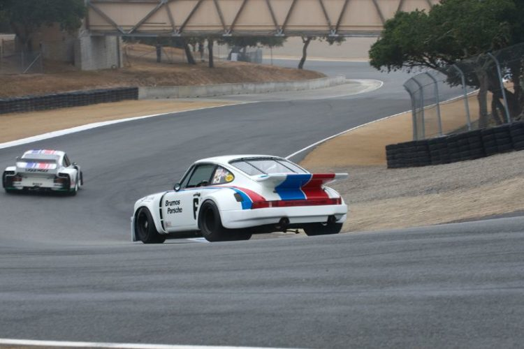 Alan Benjamin's Porsche RSR 3.0 chases Stephen Harris' Porsche 935 J down the Corkscrew.