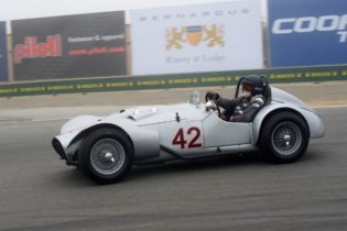 Lou Pavasi's 1954 Huffaker Special goes into turn eleven.