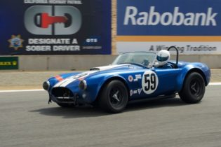 Jim Bouzaglou's 1964 Cobra 289 into turn 11.