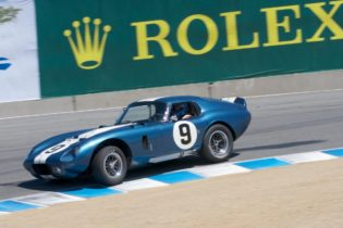 Rob Walton takes his 1965 Cobra Daytona into the Corkscrew.