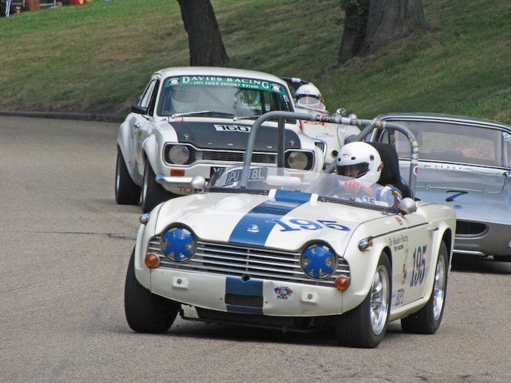 1964 Triumph TR4A leads 1963 Elva Courier Coupe and 1971 Ford Escort Mk1