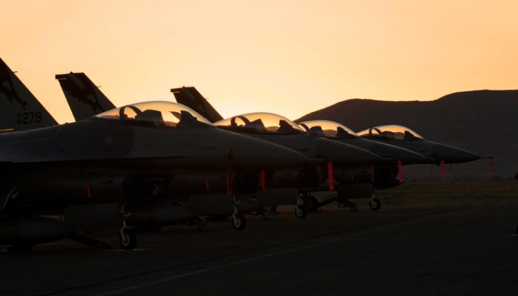 Pre dawn flight line. F-16s.