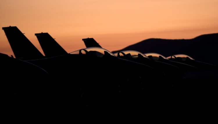 Predawn flight line F-16s.