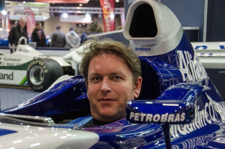 James Martin sits in an ex-Montoya F1 car on the Williams stand