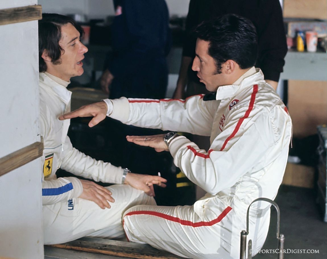 Arturo Merzario listens intently as Mario Andretti explains the NASCAR art of drafting on the high banks at Daytona. (Fred Lewis photo)