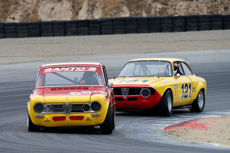 Fabrizio Rimicci's 1967 Alfa Romeo Giulia Super leads Anthony Rimicci's 1967 Alfa Romeo GTV through two.