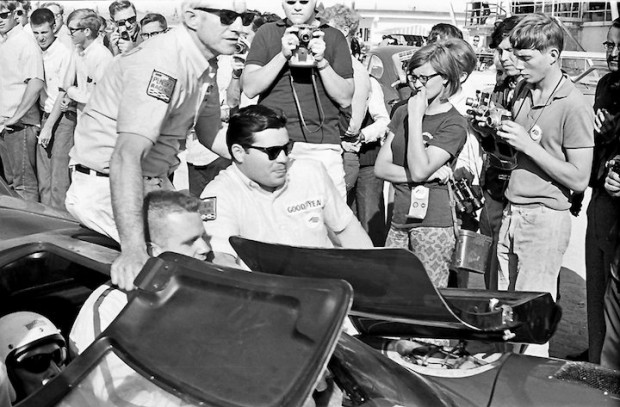 <strong>The winning #6 Penske Lola T70 Mk IIIB entering the winner's circle. Look closely and you can see the head of Donohue (with flattop haircut) practically sitting on the lap of Chuck Parsons as Chuck tries to negotiate through the crowd.</strong>