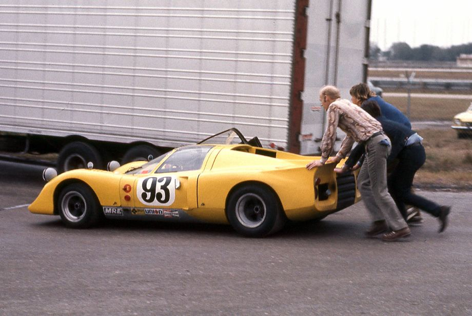 The Fisher/Gloy Chevron B16 being pushed to the starting grid.  Richard A Reeves photo.