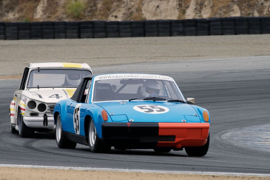 Mark Leonard's 1970 Porsche 914/6 leads Gilbert's 1969 Triumph Vitesse through turn two Saturday morning.