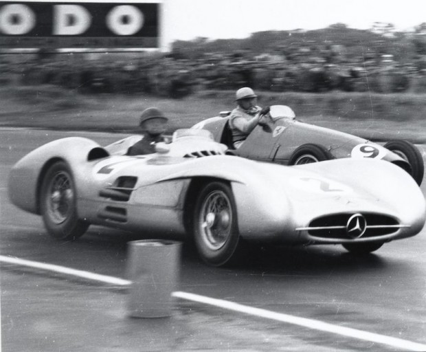 Froilan Gonzales overtakes Kling at the British Grand Prix in 1954 at Silverstone.
