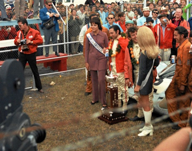 Pedro Rodriguez and Jackie Oliver enjoying the spoils of victory in the winner's circle at 1971 24 Hours of Daytona.  To the right of Rodriguez is Miss Universe and Jackie Oliver seems to be engrossed in the charms of Miss Speed Weeks (the blond with the big hair and white boots).  That young lady was a classmate of mine at Daytona Beach Junior College and she said one of the major hassles of being Miss Speed Weeks was all the married men who made unwelcome advances.  Have things changed that much since 1971?