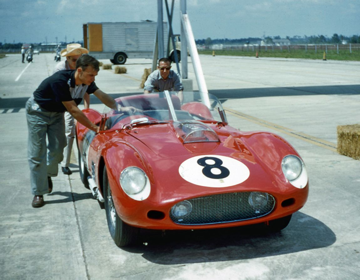 The Pete Lovely, Jack Nethercutt Ferrari 250 TR59 being pushed to the grid.  The car finished third and first in class.  BARC boys photo.
