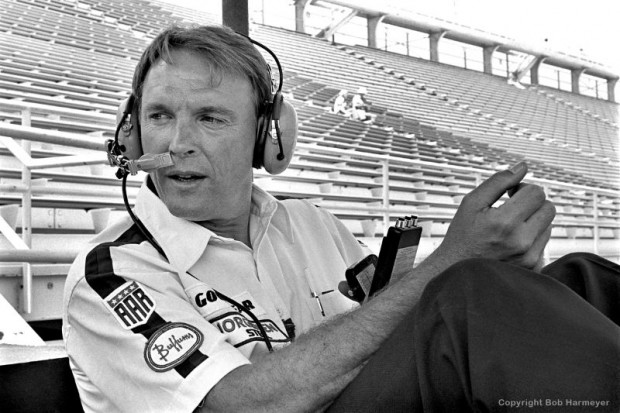Dan Gurney monitors practice from a Turn 4 observers' stand at the Speedway.